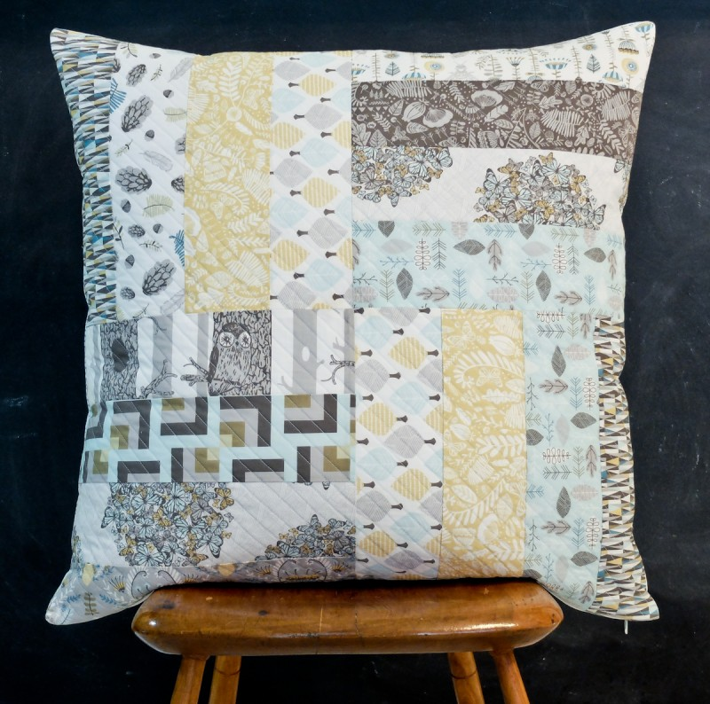 Quilted pillow cover on a chair