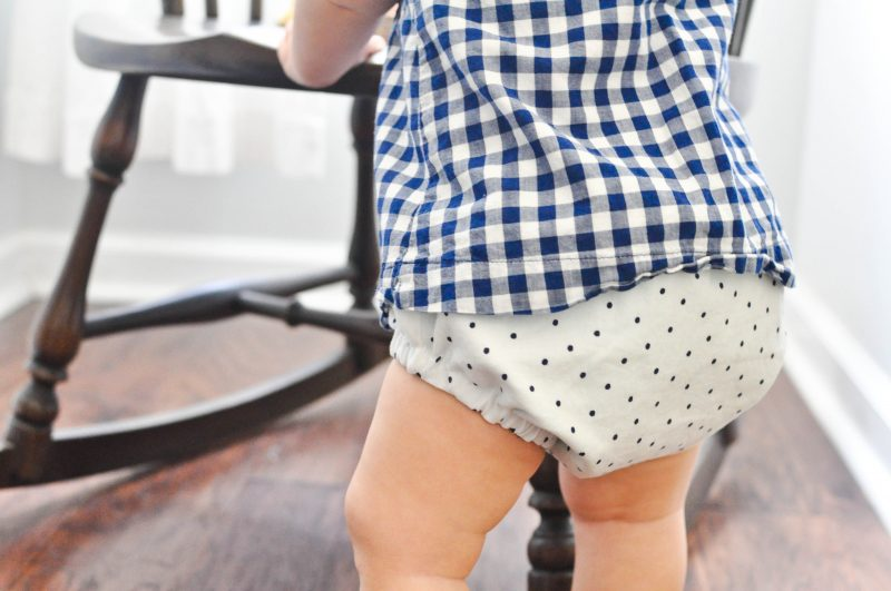 baby wearing reversible polka dot diaper cover