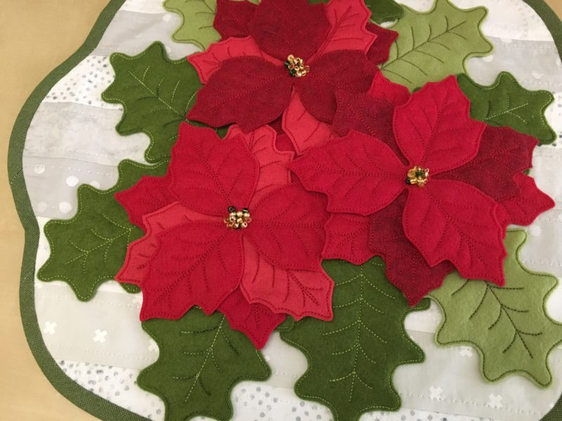felt poinsettias and holly leaves