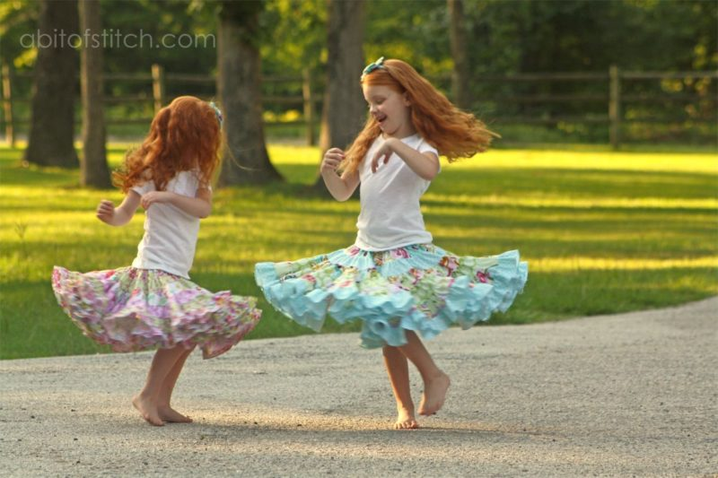 little girls dancing in ruffle skirt