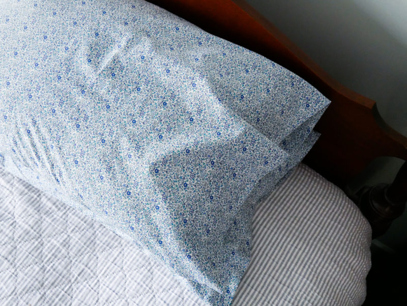 blue floral pillowcases on bed