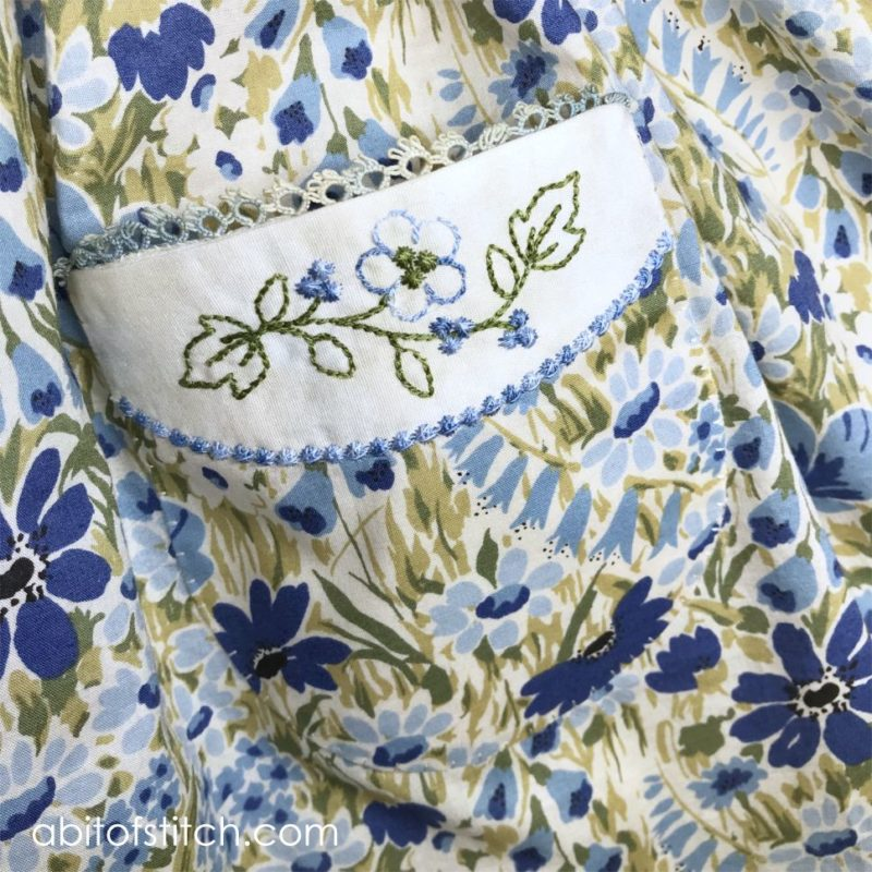 close up of pocket with flowers on dress