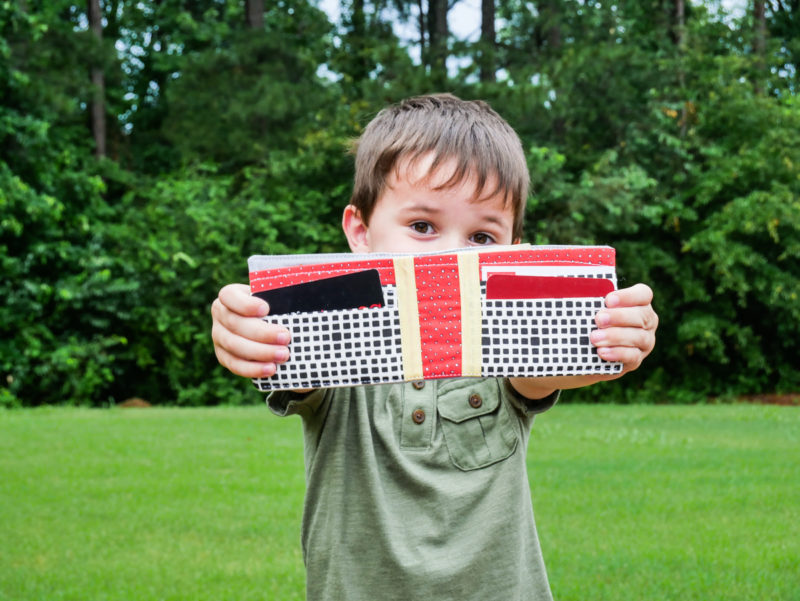 boy holding wallet he made
